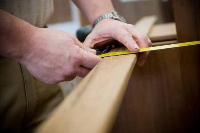 Nordic Cruiser craftsman doing precision measurement